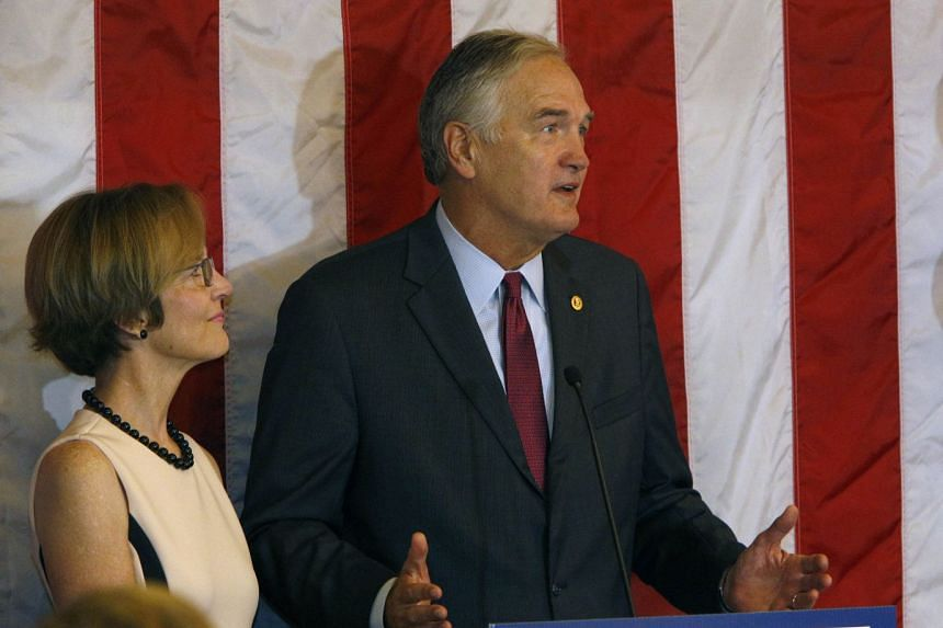 Senator Luther Strange (right) with wife Melissa at his side, makes his concession speech after losing to Roy Moore in a GOP runoff election on Sept 26, 2017.