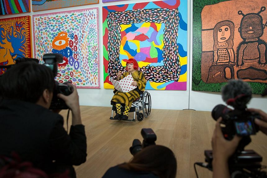 Japanese artist Yayoi Kusama attends a media preview of the Yayoi Kusama Museum and her latest works in Tokyo, Japan, on Sept 26, 2017.