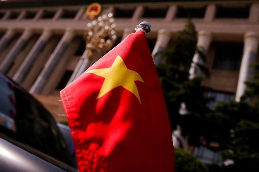 The Vietnamese national flag flies on a diplomatic car in China.