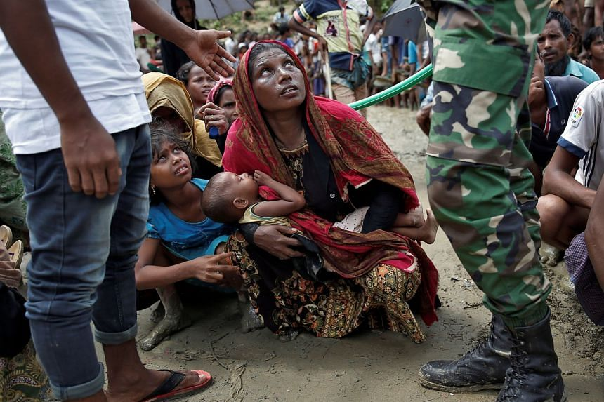 Rohingya refugees wait to receive aid in Cox's Bazar, Bangladesh, Sept 27, 2017.