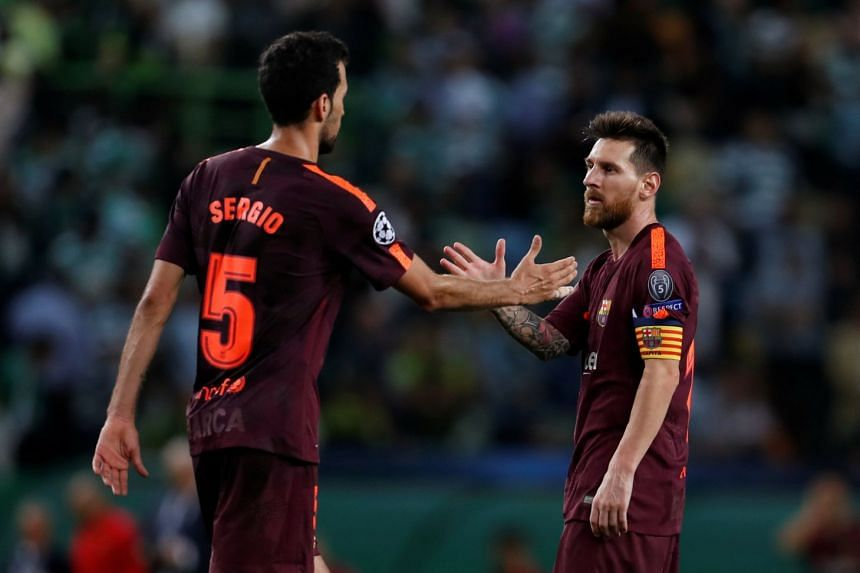 Barcelona's Lionel Messi celebrates after the match with Sergio Busquets.