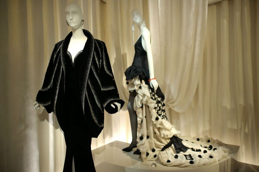A creation (front), from the Autumn-Winter 1983 collection, is displayed at the Yves Saint Laurent Museum.
