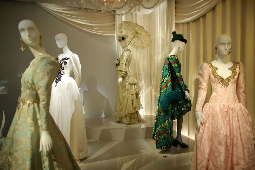 Dresses and hat creations are displayed at the Yves Saint Laurent Museum in Paris, France, Sept 27, 2017.