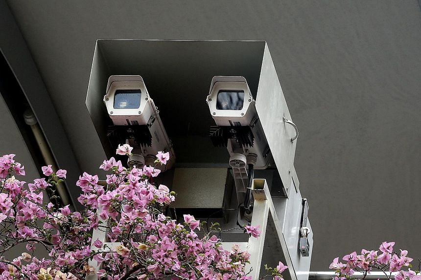 """A pair of cameras that can detect smoky vehicles were mounted on an overhead bridge in Loyang Avenue as part of the trial. The cameras will be there until December. The NEA said they are part of efforts """"to leverage sensor technology for monitoring e"""
