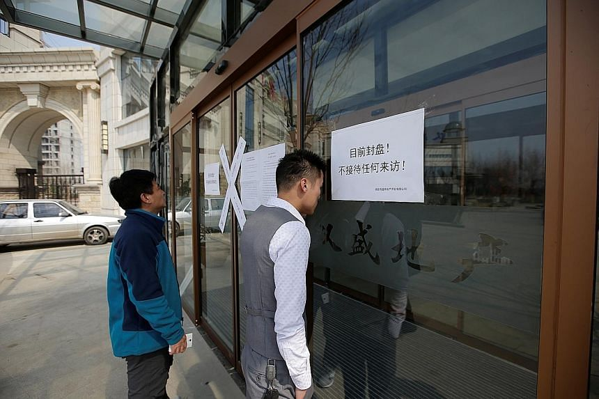 A closed real estate office in Hebei's Xiongan New Area, where officials had to ban property sales to curb a housing boom.