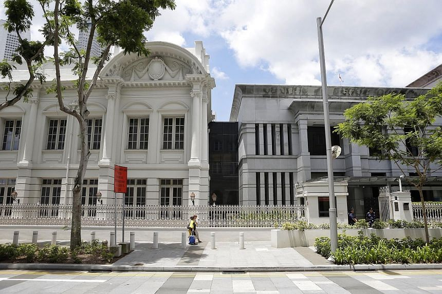 The Parliament Secretariat Office Block (left), the former AGC building where veteran legal officer Jeffrey Chan (below) started working in 1973, is connected to the newer Chamber Block via a linkway.