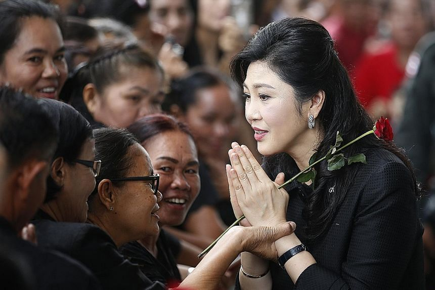 Former Thai prime minister Yingluck Shinawatra greeting supporters as she arrived for her trial in June. She fled abroad last month, fearing that the military government would seek a harsh sentence.