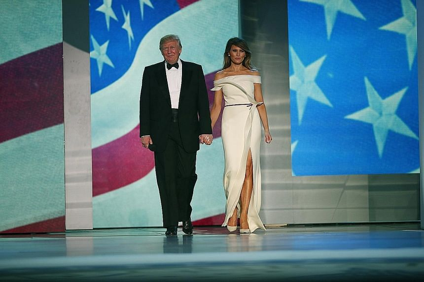 Herve Pierre created United States First Lady Melania Trump's (left, with President Donald Trump) inaugural ballgown, a vanilla silk crepe evening column.
