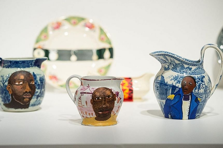 Beggar, a series of artworks by German artist Andrea Buttner, is part of her submission for the Turner Prize this year. British artist Hurvin Anderson's artwork, Peter's Sitters III (far left), on display at the Ferens Art Gallery. Pottery by Lubaina