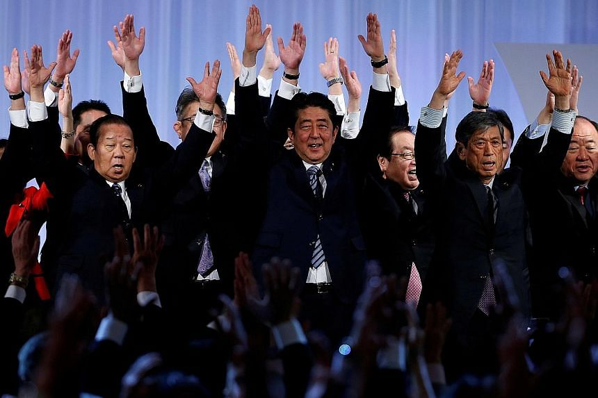 Tokyo Governor Yuriko Koike with Kibo No To (Party Of Hope) members, including former environment minister Goshi Hosono (left), during a news conference yesterday to announce the party's campaign platform. Japanese Prime Minister Shinzo Abe (centre)