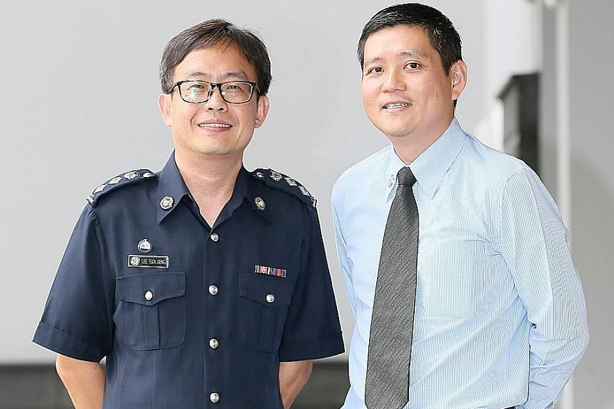 Supt Lee Teck Seng (left) and Mr Cheng Wee Kiang at the Minister's Award ceremony at the Home Team Academy yesterday.
