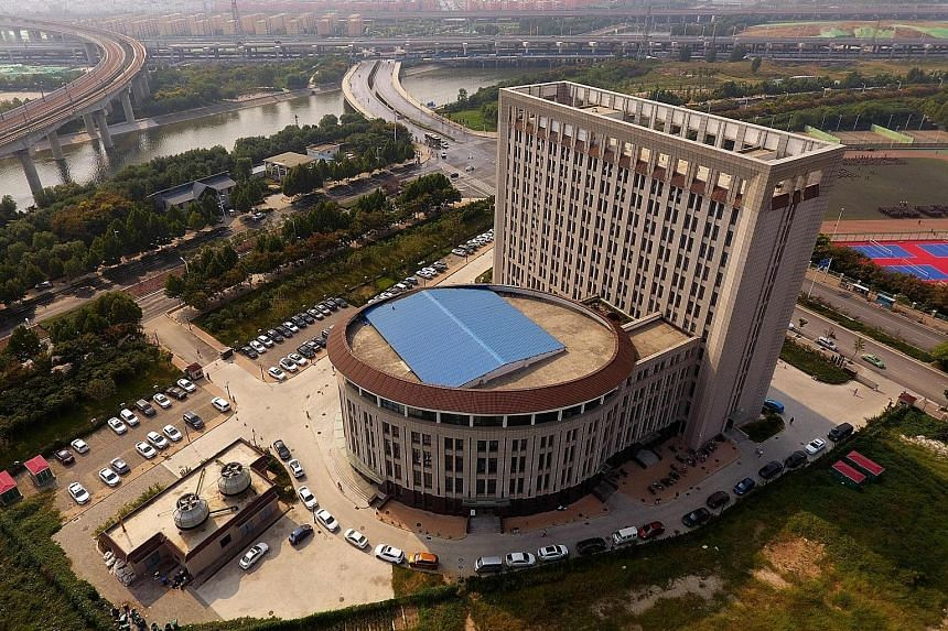 """This North China University of Water Resources and Electric Power building in Zhengzhou, Henan, has been mocked online as the """"Toilet Building""""."""