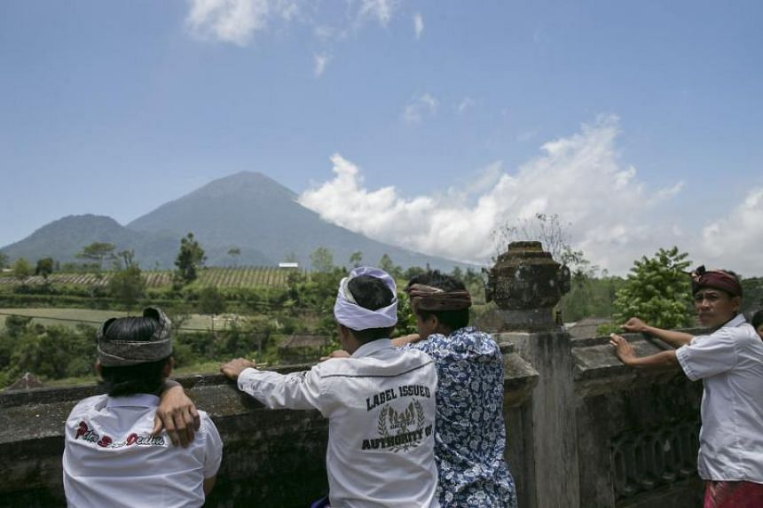 The view of Mount Agung from Pemuteran village in Karangasem, Bali, on Sept 27. The Centre for Volcanology of Geological Hazard Mitigation raised the alert level for the volcano to the highest level on Sept 22. About 100,000 people have already been
