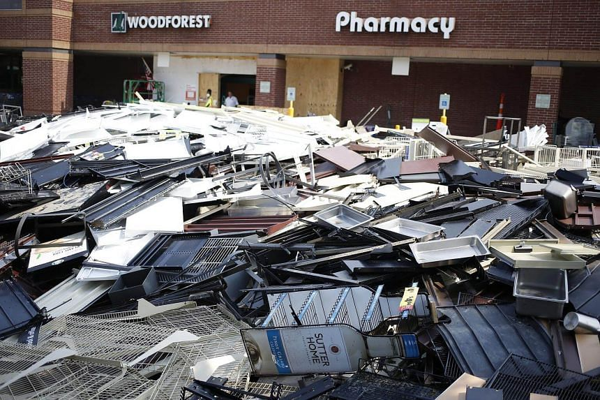 Piles of damaged store shelving sits in the parking lot outside a Kroger Co grocery store that was flooded after Hurricane Harvey in Texas, on Sept 6, 2017.