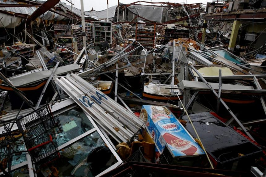 Damages are seen in a supermarket after the area was hit by Hurricane Maria in Guayama, Puerto Rico on Sept 20, 2017.