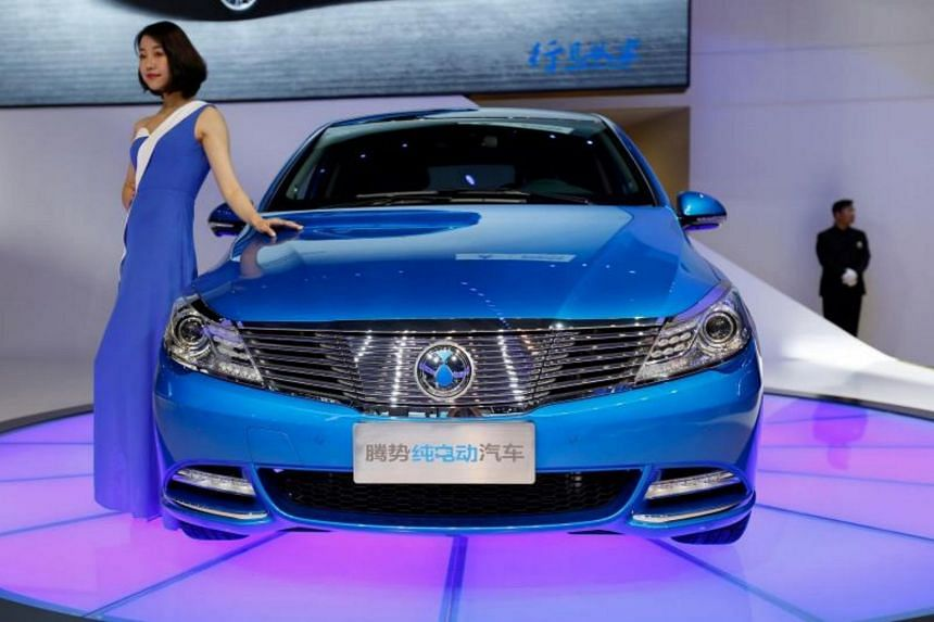 A Denza electric car is displayed to visitors at the Shanghai International Automobile Industry Exhibition on April 19, 2017.