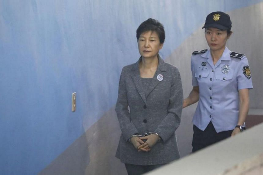 Disgraced former South Korean president Park Geun Hye arrives at a court in Seoul on Aug 25, 2017. She was named as a witness on Thursday (Sept 28) by an appeal court reviewing the conviction of billionaire heir to the Samsung Group Lee Jae Yong.