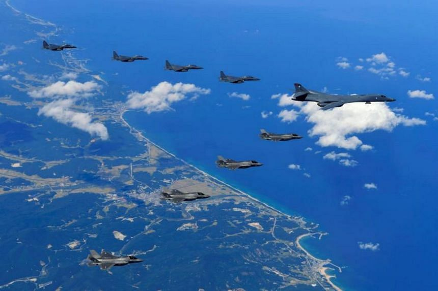 A US Air Force B-1B Lancer bomber (right), US F-35B stealth jet fighters (bottom) and South Korean F-15K fighter jets (top) flying over South Korea during a joint military drill aimed to counter North Korea's latest nuclear and missile tests.