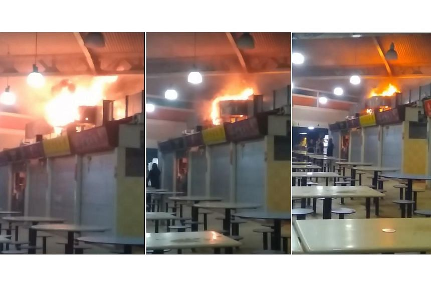 A man was taken to hospital after a fire broke out at noodle stall in Yuhua Village Market & Food Centre on Tuesday (Sept 26).