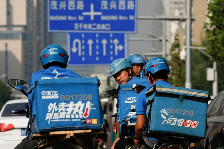 Food delivery riders preparing to begin their shift in Beijing, on Sept 21, 2017.