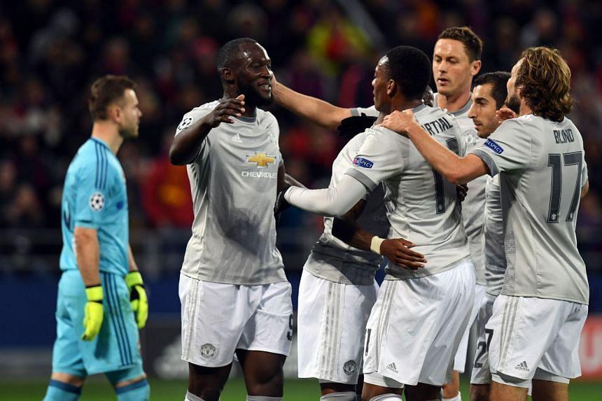 Lukaku (second left) celebrates with team mates after scoring his team's third goal.