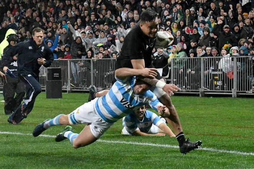 New Zealand's Vaea Fifita runs in a try as he is tackled by Argentina's Santiago Cordero during the Rugby Championship match between the New Zealand All Blacks and Argentina in New Plymouth on Sept 9, 2017.