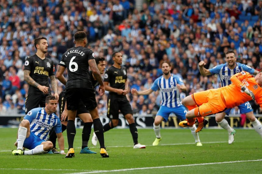 Brighton's Tomer Hemed (on ground) scores his team's winning goal against Newcastle in the Premier League on Sept 24, 2017.
