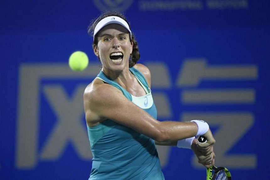 Johanna Konta of Britain hits a return against Ashleigh Barty of Australia during their first-round match at the WTA Wuhan Open on Sept 25, 2017.