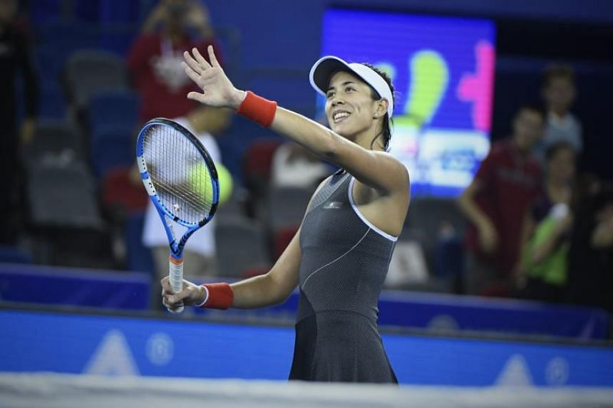 Garbine Muguruza of Spain celebrates after winning against Magda Linette of Poland during their third round singles match at the WTA Wuhan Open on Sept 27, 2017.