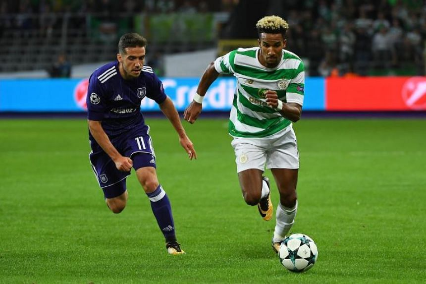Celtic's Scott Sinclair (right) fights for the ball with Anderlecht's Alexandru Chipciu during the Champions League Group B match at The Constant Vanden Stock Stadium in Brussels on Sept 27, 2017.