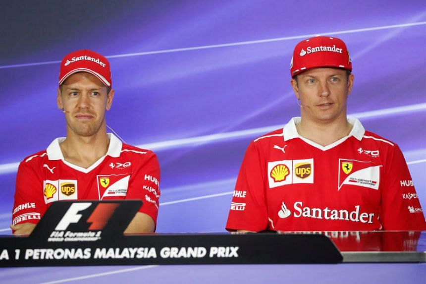 Ferrari's Sebastian Vettel (left) and team-mate Kimi Raikkonen speaking during a news conference on Sept 28, 2017, ahead of the Malaysian Grand Prix.