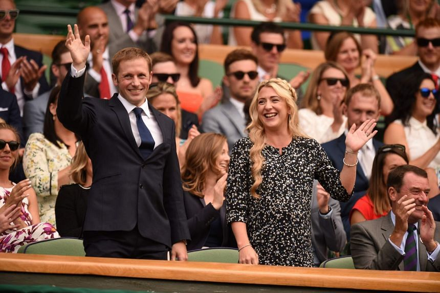 Six-time Olympic cycling champion Jason Kenny (left) and wife, four-time Olympic cycling champion Laura Trott, at the 2017 Wimbledon Championships at The All England Lawn Tennis Club in Wimbledon, southwest London, on July 8, 2017.