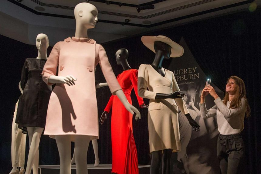 A display of outfits during a preview of Audrey Hepburn's personal collection at Christie's auction house in central London on Sept 22, 2017.
