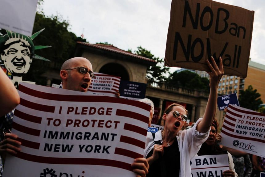 People taking part in a rally to protest restrictive guidelines issued by the US on who qualifies as a close familial relationship under the Supreme Court order on the Muslim and refugee ban at Union Square in New York, on June 29, 2017.