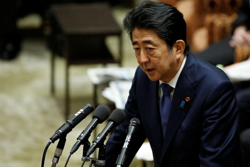 Japan's Prime Minister Shinzo Abe at a Lower House budget committee session in Parliament in Tokyo on July 24, 2017.