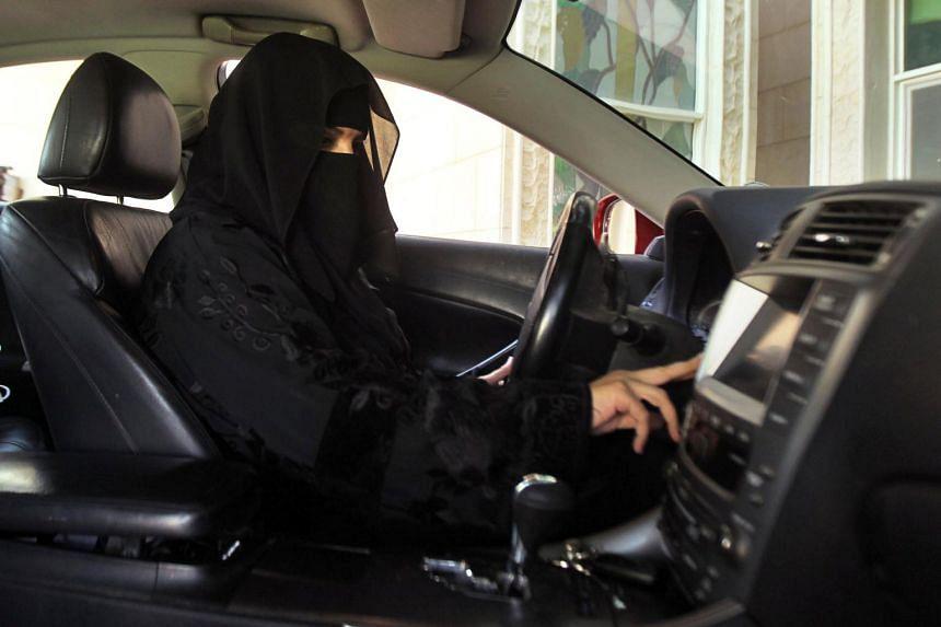 A woman drives a car in Saudi Arabia, on Oct 22, 2013.