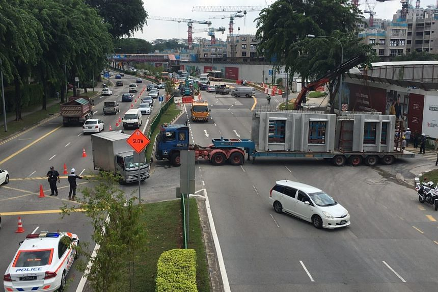 The trailer was turning out of a construction site for Build-To-Order development Alkaff Vista onto Upper Serangoon Road when it broke down because of a mechanical fault.