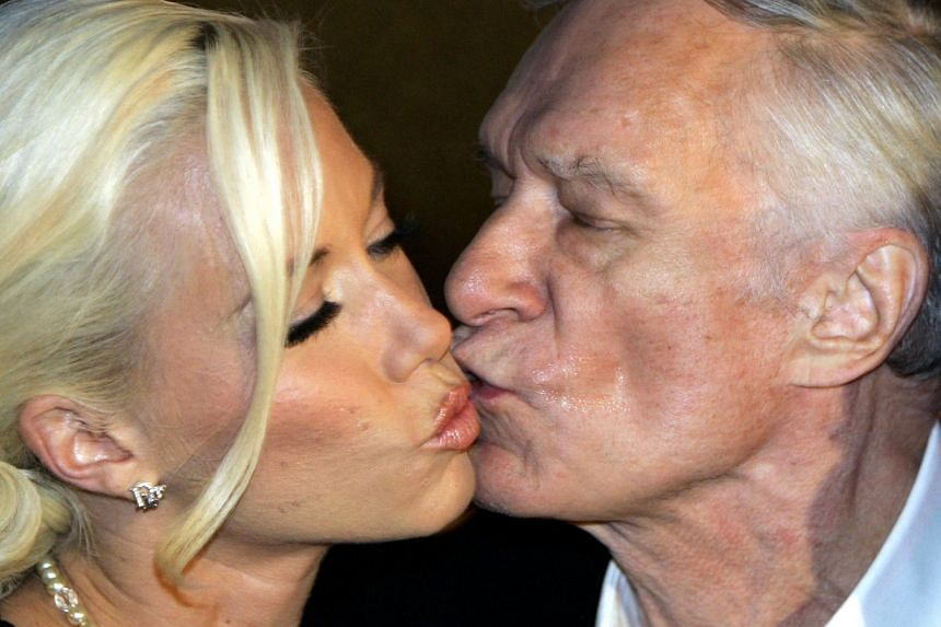 Playboy magazine founder Hugh Hefner kisses girlfriend Kendra Wilkinson at his 80th birthday party in Munich's famous club P1 on May 31, 2006.