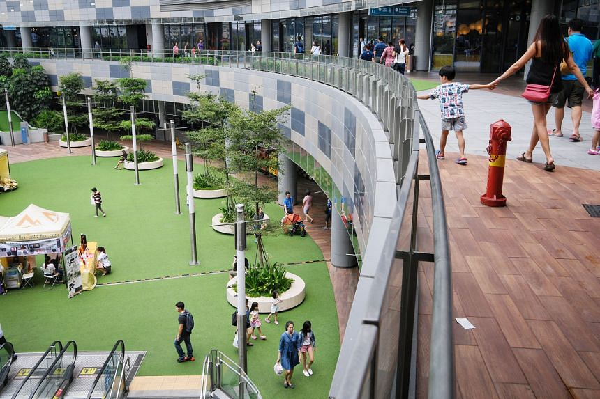 Older towns such as Ang Mo Kio have hawker centres and street-level shops where residents can mingle, features lacking in newer estates with their mall-based neighbourhood centres like Punggol's Waterway Point (above).