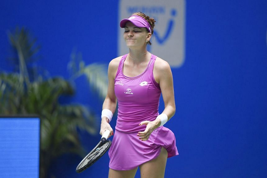 Pole Agnieszka Radwanska reacting after losing a point against Australian Ashleigh Barty during their third-round match at the Wuhan Open. The Pole, the ninth seed, fell 6-4, 0-6, 4-6 to join a host of seeded players out of the tournament.