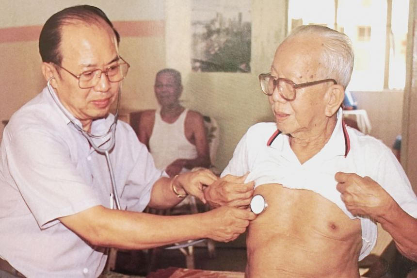 Dr Khoo volunteering at the Rochor Kongsi Home for the Aged, in this photo taken in 1989. He was one of the grassroots leaders who founded the home. Dr George Khoo Swee Tuan at his new clinic in Veerasamy Road. He moved there last year after running