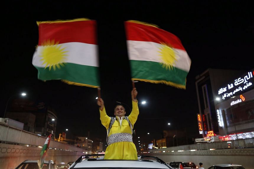 Kurds celebrate in Erbil after the announcement of the results of the independence referendum.