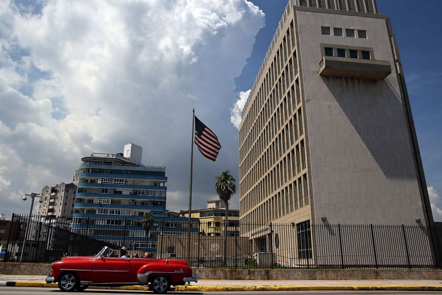 A car passes in front of the US embassy in Havana, Cuba.