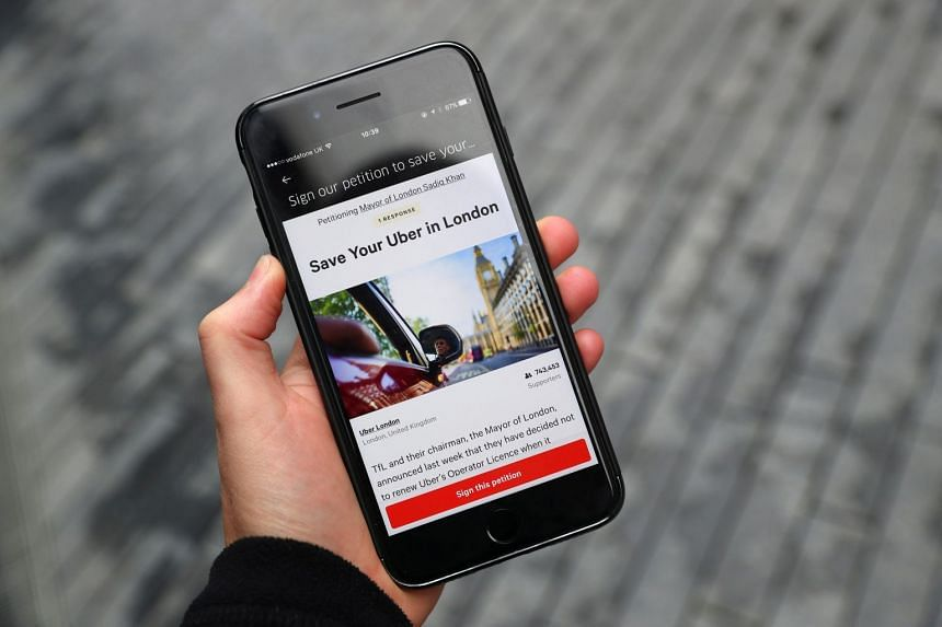 A message on the Uber app is seen on a mobile telephone in London, Sept 25, 2017.