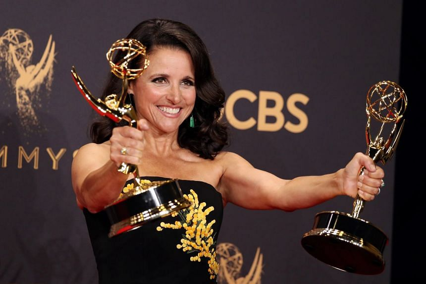 Julia Louis-Dreyfus holds her 2017 Emmys for Outstanding Lead Actress in a Comedy Series and Outstanding Comedy Series for Veep.