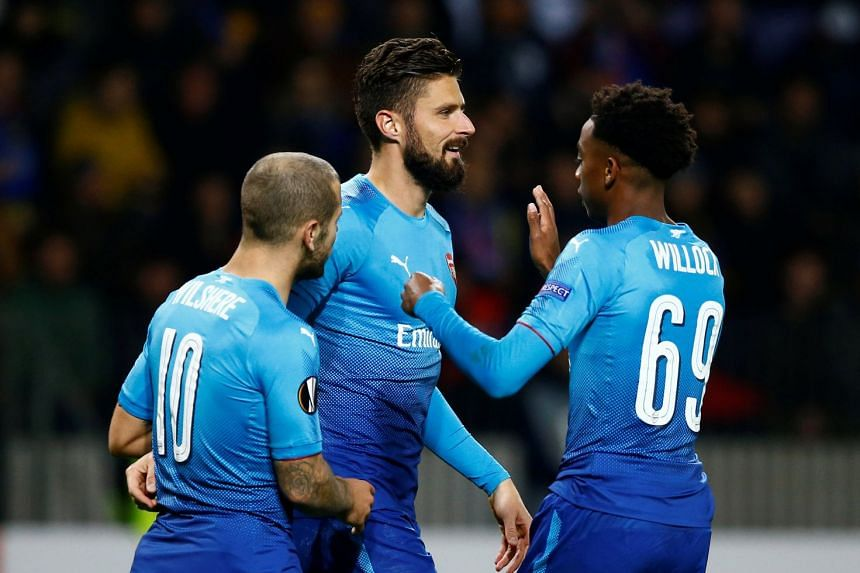 Arsenal's Olivier Giroud celebrates scoring their fourth goal with Joseph Willock and Jack Wilshere.