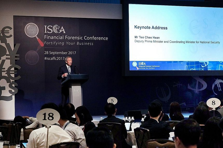 Deputy Prime Minister Teo Chee Hean delivering his keynote address at the Institute of Singapore Chartered Accountants Financial Forensic Conference yesterday. He said the authorities will work with the private sector to target individuals involved i