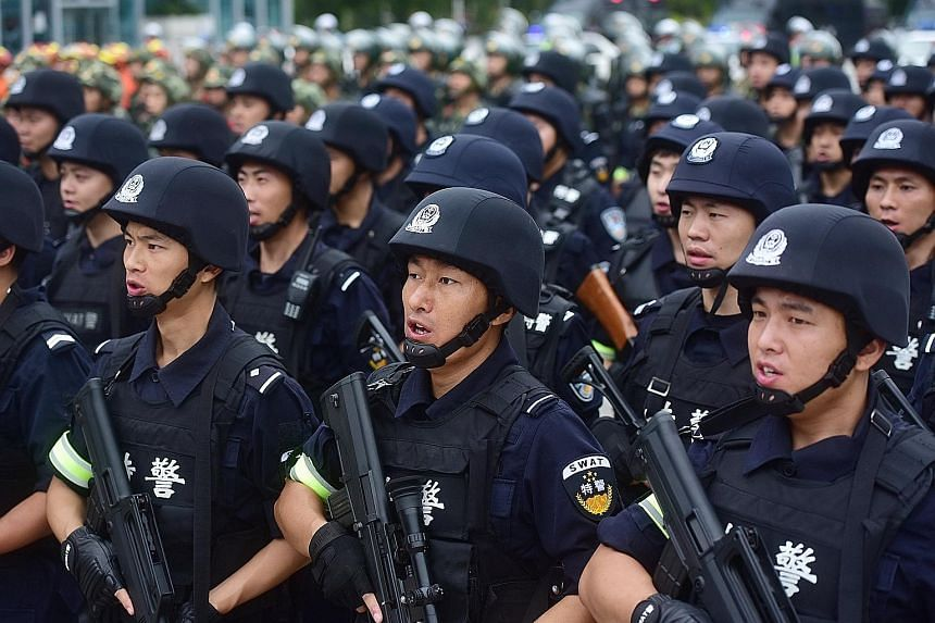 Special force police officers taking part in a security oath-taking drill in Sichuan province this week, ahead of the 19th National Congress of the Chinese Communist Party next month.