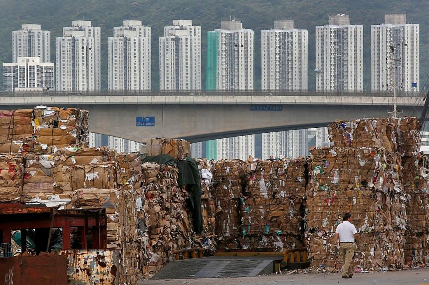 Stacks of paper waste at a dock in Hong Kong, after China imposed a ban on imports of 24 types of rubbish, including unsorted scrap paper, in July.