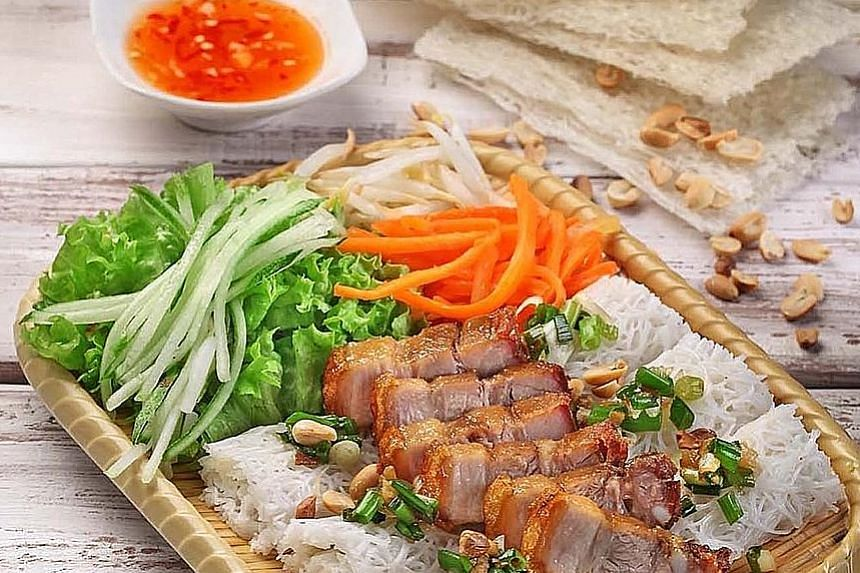 Rice vermicelli with grilled pork belly and spring roll with pickled carrots and radish at Pho Street.